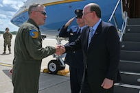 Col. John Pogorek, 157th Air Refueling Wing commander, greets Matthew Donovan, the acting secretary of the Air Force, on the flight line at Pease Air National Guard Base, Aug. 8, 2019.
