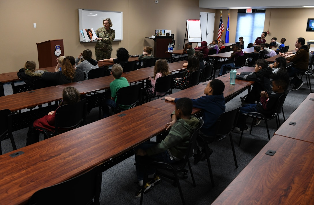 Col. Jennifer Reeves, 341st Missile Wing commander, reads to children at the Youth Center Feb. 12, 2020, at Malmstrom Air Force Base, Mont.