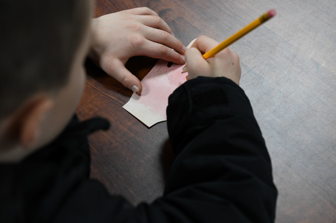 A child writes his dream on a paper hand during a Black History Month event at the Youth Center Feb. 12, 2020, at Malmstrom Air Force Base, Mont.