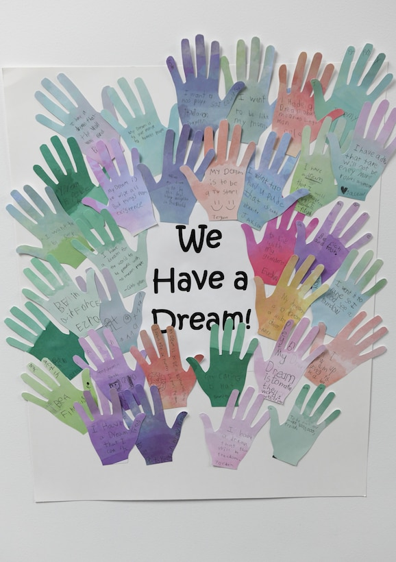 Children at the Youth Center write their dreams on paper hands to create a wall display during a Black History Month event at the Youth Center Feb. 12, 2020, at Malmstrom Air Force Base, Mont.