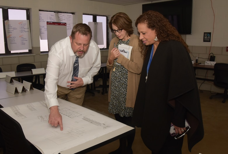 From left to right, Mr. David Conner, 460th Force Support Squadron Force Development Flight chief, Mrs. Tonia Shaw, the Combined Force Space Component commander, U.S. Space Command spouse, and Mrs. Alicia Pepper, the 460th Space Wing commander's spouse looks at plans for the expansion of the Professional Development Campus on Buckley Air Force Base, Colo. Feb. 21, 2020.