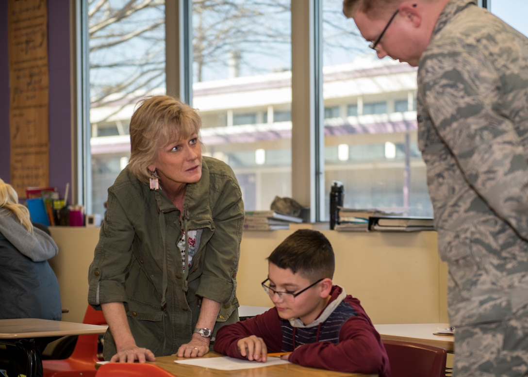 Wendy Winters, a Desert Junior-Senior High School teacher, and 1st Lt. Joshua Rice, 772nd Test Squadron, tutors a student at Edwards Air Force Base, Feb. 19. (Air Force photo by Giancarlo Casem)