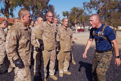 Sgt Kristopher Scheuer with Mike Company, 3rd Recruit Training Battalion, encourages recruits with Mike Company, 3rd Recruit Training Battalion, during the Combat Conditioning Course at Marine Corps Recruit Depot, San Diego, Feb. 19, 2020. Throughout the course, recruits rotated through different stations executing different Marine Corps Martial Arts techniques. (U.S. Marine Corps photo by Lance Cpl. Maria A. Estrada)