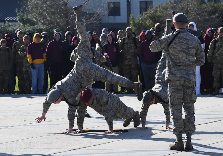 Members of the 335th Training Squadron freestyle drill team perform during the 81st Training Group drill down on the Levitow Training Support Facility drill pad at Keesler Air Force Base, Mississippi, Feb. 21, 2020. Airmen from the 81st TRG competed in a quarterly open ranks inspection, regulation drill routine and freestyle drill routine. Keesler trains more than 30,000 students each year. While in training, Airmen are given the opportunity to volunteer to learn and execute drill down routines. (U.S. Air Force photo by Kemberly Groue)