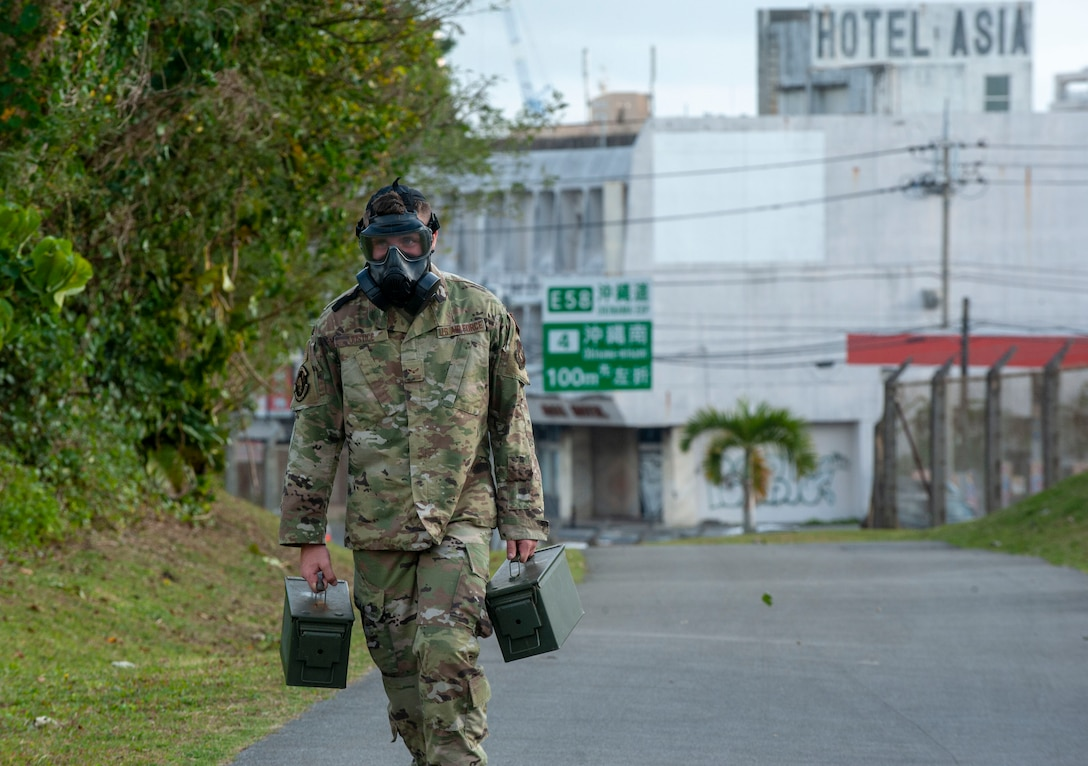 U.S. Air Force Airman 1st Class Michael Justice, 18th Security Forces Squadron response force leader, runs the Habu Trail during the Defenders Challenge Feb. 13, 2020, at Kadena Air Base, Japan. This Defenders Challenge tested basic combat skills and competitor knowledge at various stations along the course. (U.S. Air Force photo by Naoto Anazawa)