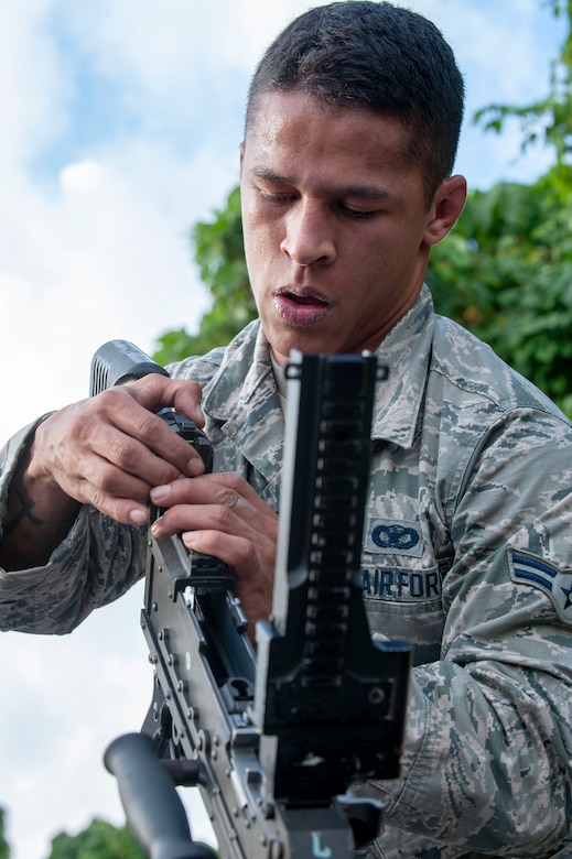 U.S. Air Force Airman 1st Class Samuel Gonzales, 18th Security Forces Squadron armorer, assembles an M240 machine gun during the Defenders Challenge Feb. 13, 2020, at Kadena Air Base, Japan. The members participated in the Defenders Challenge, an event challenging participants to run through an obstacle course designed to test their physical and mental abilities. (U.S. Air Force photo by Naoto Anazawa)