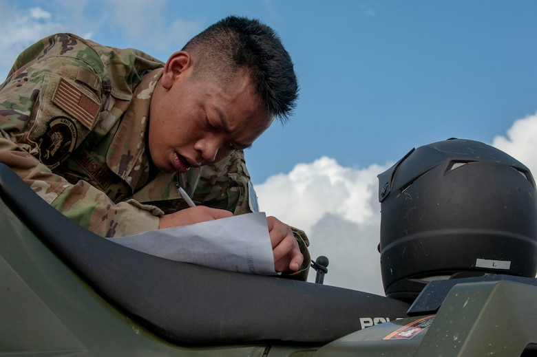 U.S. Air Force Airman 1st Class Wutthiphong Chaturaksamai, 18th Security Forces Squadron response force leader, fill outs a challenge worksheet during the Defenders Challenge Feb. 13, 2020 at Kadena Air Base, Japan. This was one of several events participants had to overcome during the Defenders Challenge varying from physical exercise, a three-mile run, to weapon assembly. (U.S. Air Force photo by Naoto Anazawa)