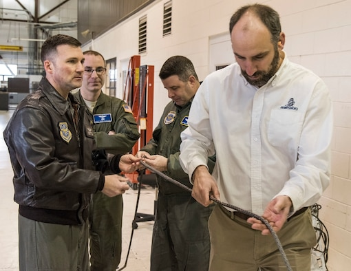 Personnel from the Air Force Research Lab, Wright-Patterson Air Force Base, Ohio and Samson Rope, Ferndale, Wash., demonstrate proposed items for the C-17 Globemaster III fleet Jan. 30, 2018, on Dover Air Force Base, Del. Maintenance personnel from the 736th Aircraft Maintenance Squadron set up an aircraft and back-shop facilities to gather additional data for synthetic rope chains and winch cable usage. (U.S. Air Force photo/Roland Balik)