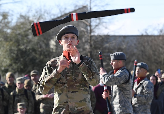 U.S. Air Force Airman 1st Class Ethan Fowler, 335th Training Squadron freestyle drill team member, spins a rifle during the 81st Training Group drill down on the Levitow Training Support Facility drill pad at Keesler Air Force Base, Mississippi, Feb. 21, 2020. Airmen from the 81st TRG competed in a quarterly open ranks inspection, regulation drill routine and freestyle drill routine. Keesler trains more than 30,000 students each year. While in training, Airmen are given the opportunity to volunteer to learn and execute drill down routines. (U.S. Air Force photo by Kemberly Groue)