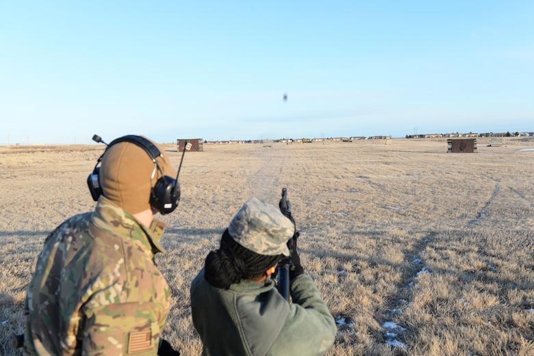 Airman Fires Grenade Launcher