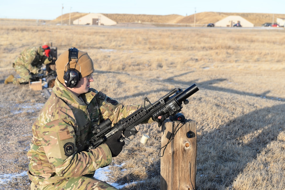 Combat Arms Instructor reloads grenade launcher
