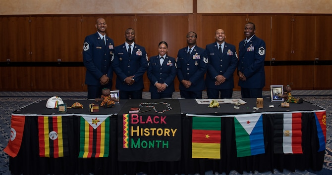 Members of the 52nd Fighter Wing African American Heritage Committee pose for a photo at the annual Black History Month Luncheon at Spangdahlem Air Base, Germany, Feb. 24, 2020. The committee organized a display of authentic cultural artifacts from various African heritages during the luncheon. (U.S. Air Force photo by Airman 1st Class Alison Stewart)