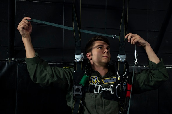 Photo of an emergency parachute training student practicing emergency parachute procedures.