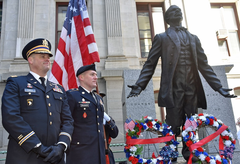 Maj. Louis Fabrizi (left) and Staff Sgt. Brian Brandmeir (right) stand at the foot of the Major Octavius V. Catto Memorial after a wreath laying ceremony on Feb. 22, 2020 honoring the Civil War-era militia officer and African-American civil rights leader from Philadelphia. Both men were  awarded The Major Octavius V. Catto Medal, which is bestowed upon guardsmen and women who display qualities of selfless service in the military and local community. (U.S. Air National Guard photo by Senior Airman Wil Acosta)