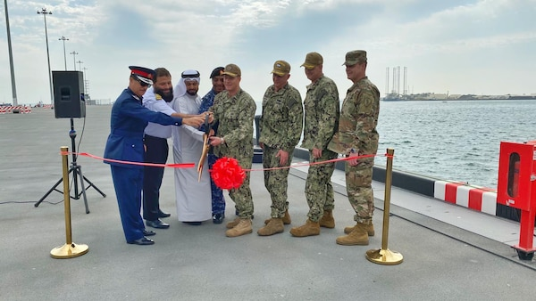 Capt. Greg Smith, commanding officer of Naval Support Activity (NSA) Bahrain, cuts a ribbon with senior American and Bahraini leaders to celebrate the opening of the renovated Mina Salman Pier. NSA Bahrain enables the forward operations and responsiveness of U.S. and allied forces in support of Navy Region Europe, Africa, Central's mission to provide services to the fleet, warfighter and family
