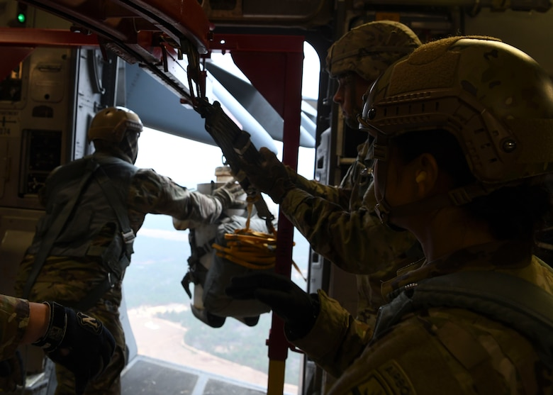 Soldiers assigned to the Airborne and Special Operations Test Directorate at Fort Bragg, N.C., eject a test mannequin out of a C-17 Globemaster III over Pope Army Airfield, N.C., Feb. 20, 2020.
