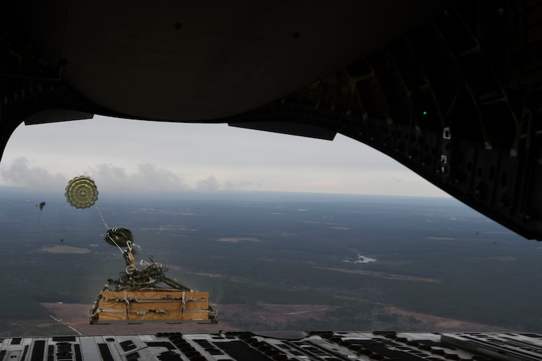 A loadmaster ejects a humvee out of a C-17 Globemaster III over Pope Army Airfield, N.C., Jan. 19, 2020. Airmen from the 15th AS integrated with the ABNSOTD to conduct air drop training for both services.