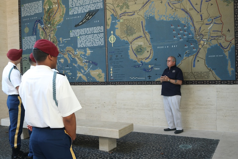 Bobby Bell, American Battle Monuments Commission deputy superintendent, talks to soldiers from the 2nd Battalion, 503rd Infantry Regiment in Vicenza, Italy, during the 75th anniversary of the retaking of Corregidor Island ceremony at the Manila American Cemetery in Manila, Philippines, Feb. 17, 2020.