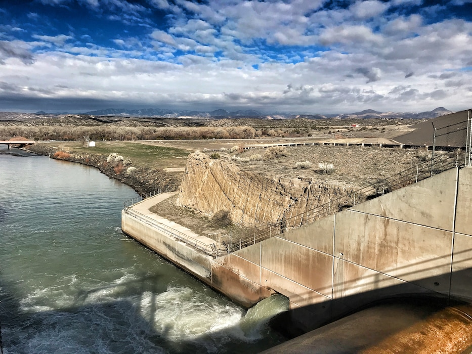 On the photographer's first day on the job, the Cochiti Lake maintenance crew prepared the outlet to allow irrigation water to flow to the canals, March 4, 2019. Photo by Karyn Matthews.
