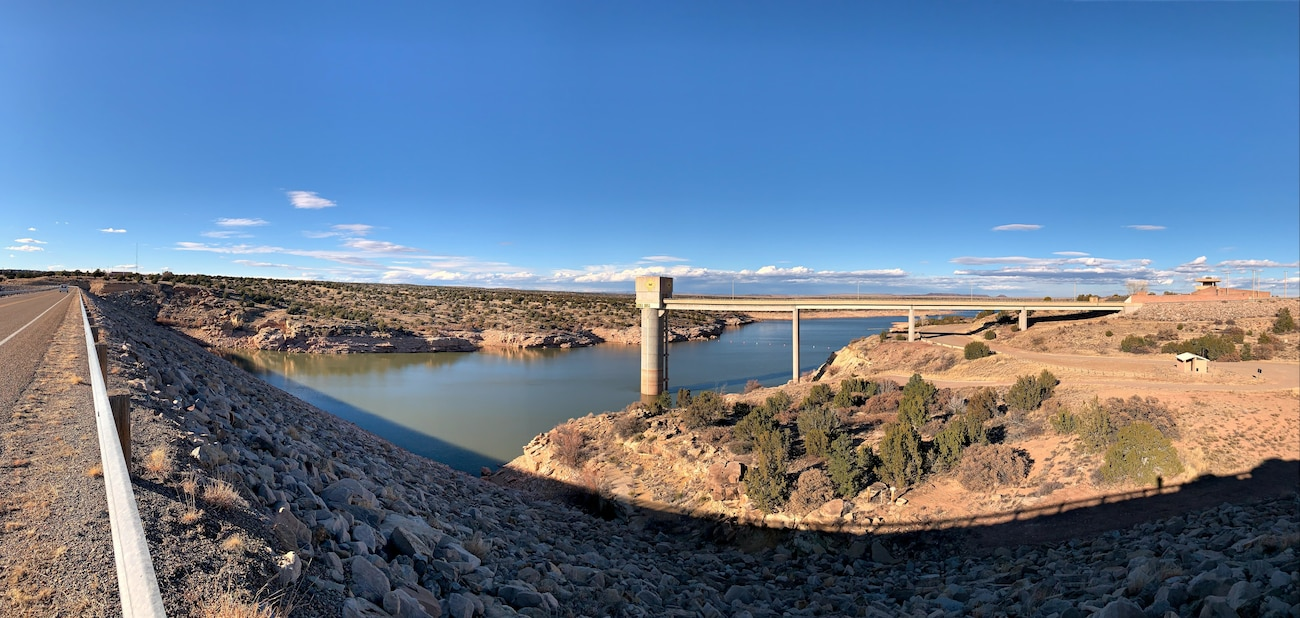 View of Santa Rosa Dam's upstream embankment face, the reservoir, the service bridge and tower, and the visitor center overlook at sunset, Feb. 10, 2020. Photo by Cristobal Marquez.