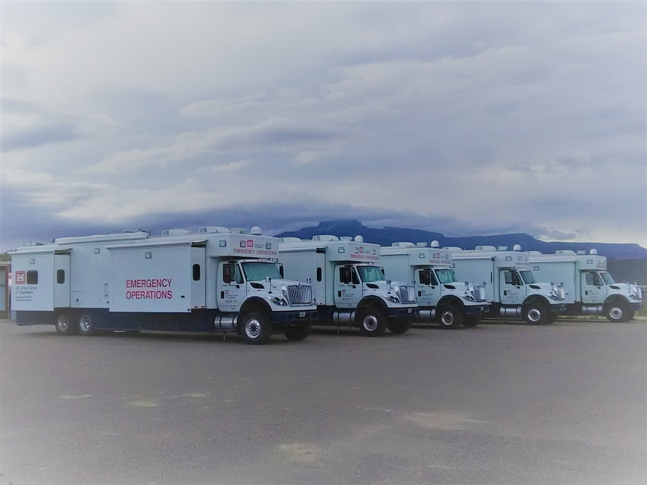 Five Emergency Command and Control Vehicles (ECCVs) line up outside of the Trinidad Lake project office, April 17, 2019, during a Deployable Tactical Operations System (DTOS) exercise.  Photo by Kim Falen.