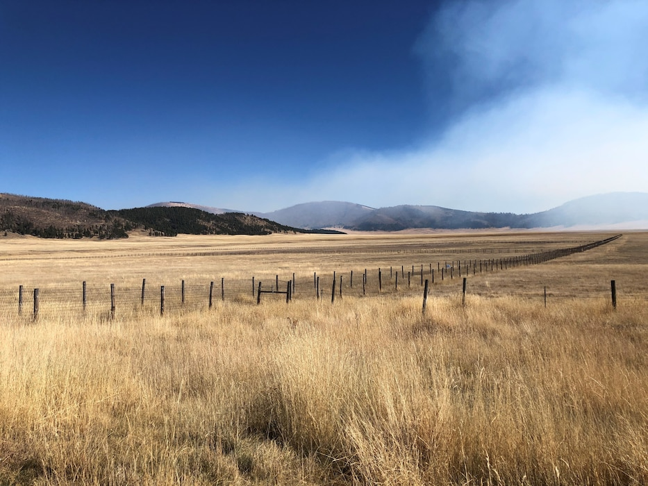 Smoke from a controlled burn drifts over the Valle Grande, Oct. 1, 2019. District staff participated in a site visit at the Valles Caldera National Preserve to meet with stakeholders to consider how USACE might support the introduction of wild horses into the area. During the visit, a controlled burn was conducted just west of the Valles Grande. Photo by Mike Goodrich.