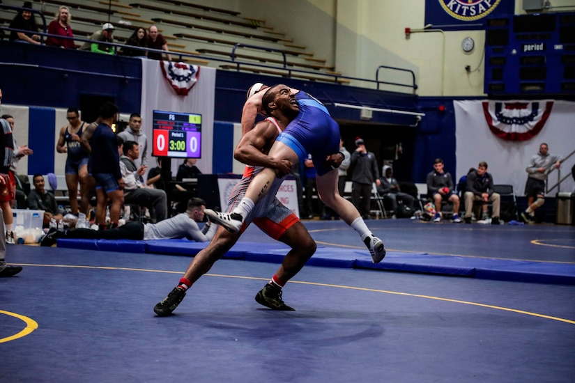 NAVAL BASE KITSAP, Wa. (Feb. 23, 2020) - Sgt. Isaac Dukes with the U.S. Army wrestling team competes against Sgt. Raymond Bunker with the U.S. Marine Corps wrestling team in the Freestyle event during the final round of the 2020 Armed Forces Sports Wrestling Championship at the Bremeton Fitness Complex. (U.S. Navy Photo by Mass Communication Specialist 1st Class Ian Carver/RELEASED).