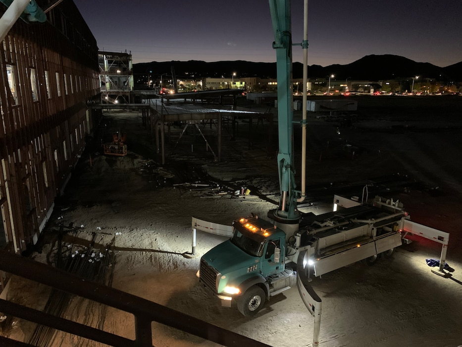 Workers pump concrete at dawn at the NNSA Albuquerque Complex site, Oct. 31, 2019. Photo by Garry Vollbrecht.