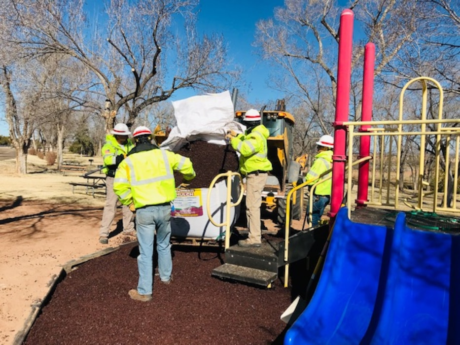 Conchas Lake staff spread rubber mulch in the Captain Kramer playground day use area, Feb. 28, 2019. Photo by Nadine Carter.