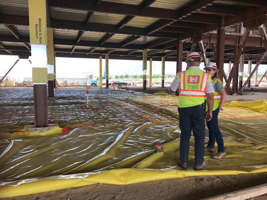 Garry Vollbrecht, construction control representative at the USACE KAFB Resident Office, explains to Tracy Wolf, district safety manager, the procedures that have to take place prior to pouring concrete on the first floor of the NNSA Albuquerque Complex, Aug. 14, 2019. Photo by Lucia Pillera.