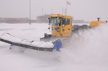 148th Fighter Wing Civil Engineer Squardron removes snow after a November storm