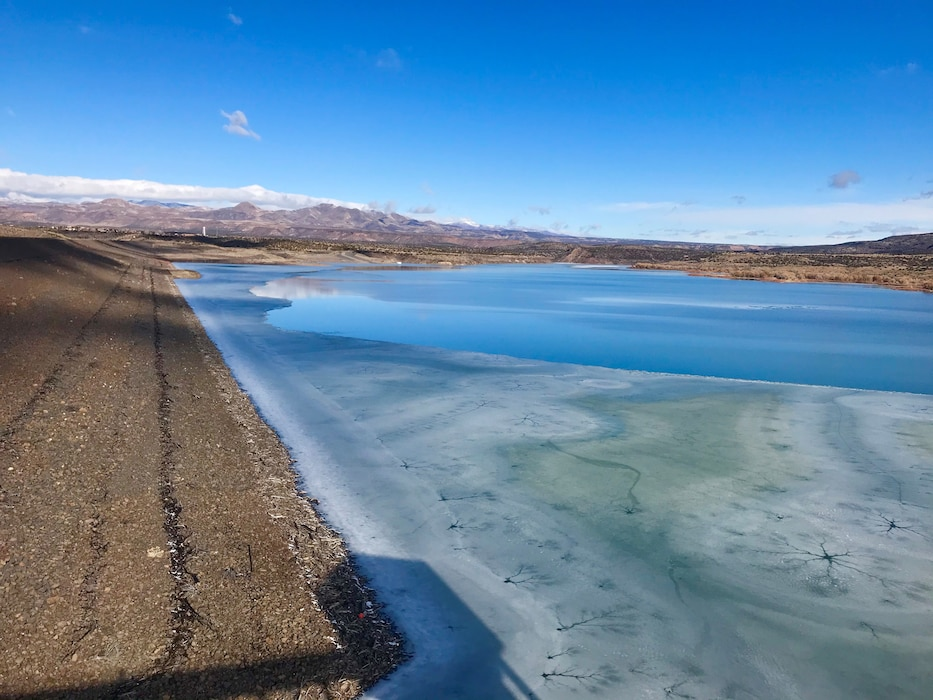 Looking west at a frozen Cochiti Lake with snow-capped mountains in the distance, Jan. 22, 2020. Photo by Lucia Pillera.