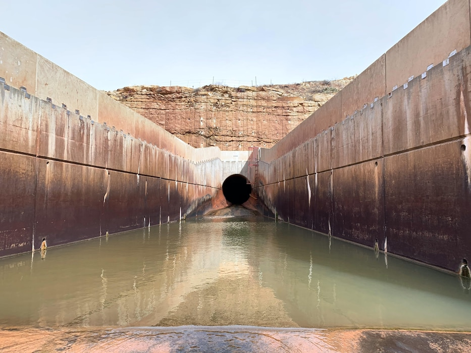 Santa Rosa Dam's outlet works, including the conduit, flip bucket, parapet walls and Pecos River discharge, as seen during the annual inspection, Feb. 10, 2020. Photo by Cristobal Marquez.
