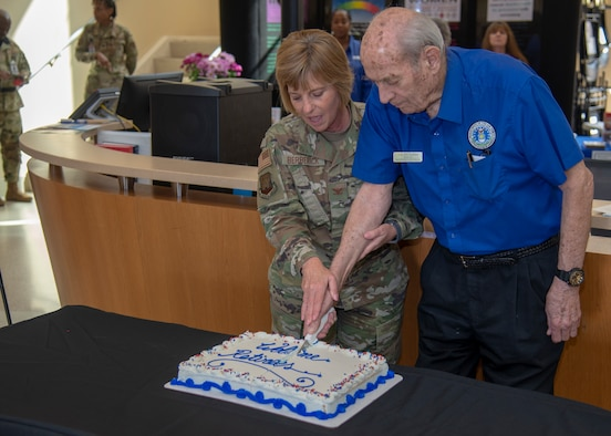 U.S. Air Force Col. Christine Berberick, the 6th Medical Group commander, cuts a ceremonial cake with retired Col. William Graham, the MacDill Retiree Activities Office director, at the Retiree Appreciation Day event Feb. 22, 2020, at MacDill Air Force Base, Fla.