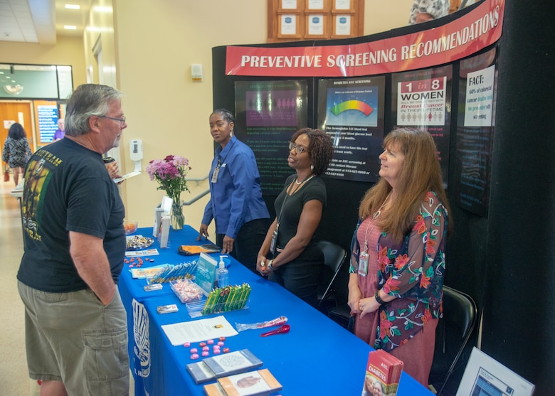 A retiree at MacDill Air Force Base asks a question about preventive screening during the annual Retirement Appreciation Day event Feb. 22, 2020, at MacDill Air Force Base, Fla.