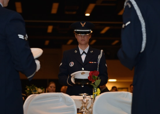 Goodfellow Air Force Base Honor Guard members set the POW/MIA table during the 27th Annual Awards Ceremony at the McNeese Convention Center in San Angelo, Texas, Feb. 21, 2020. The yearly awards were presented to members of each branch for a variety of categories. (U.S. Air Force photo by Airman 1st Class Robyn Hunsinger)