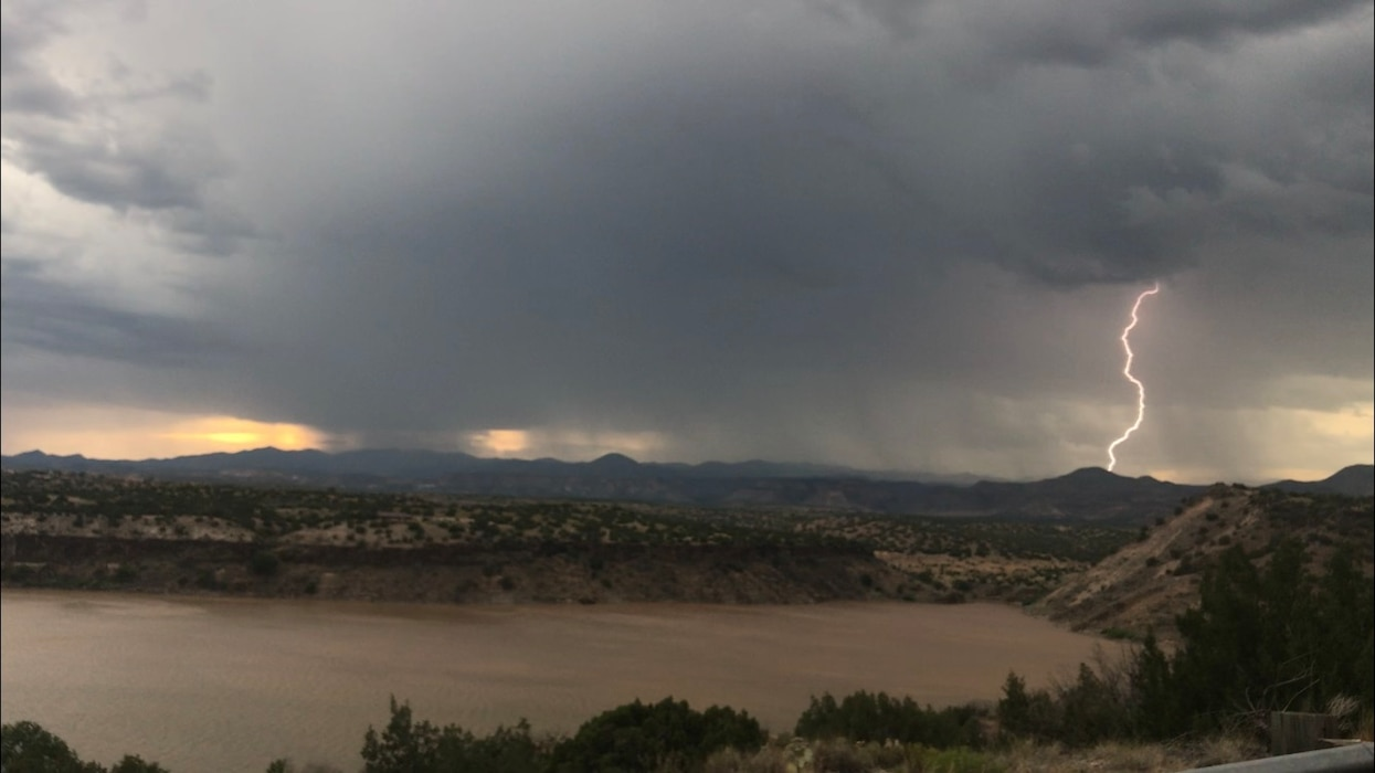 A bolt of lightning strikes during a monsoon storm at Cochiti Lake, July 25, 2019. Photo by Karyn Matthews.