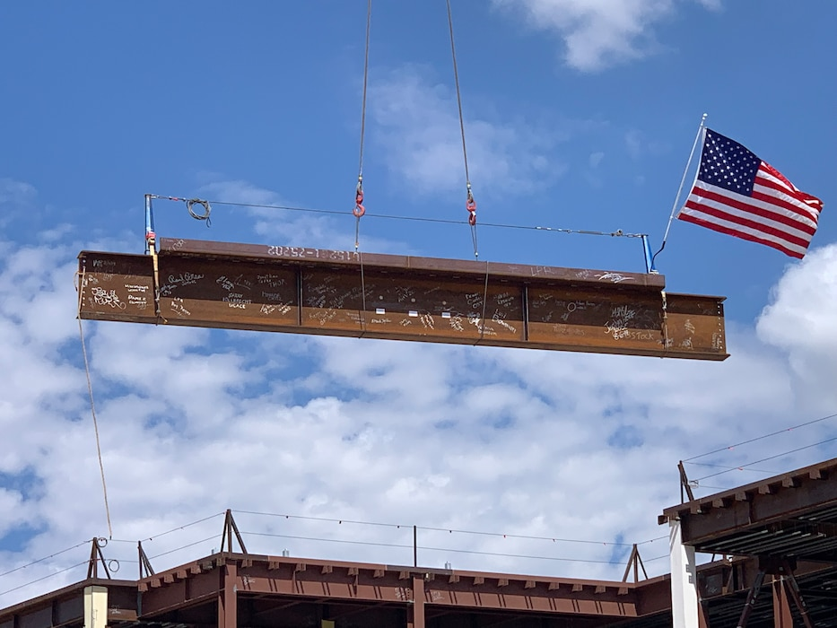 A crane places the final structural beam in place during a Topping Out ceremony at the NNSA Albuquerque Complex, Aug. 6, 2019. Photo by Garry Vollbrecht.