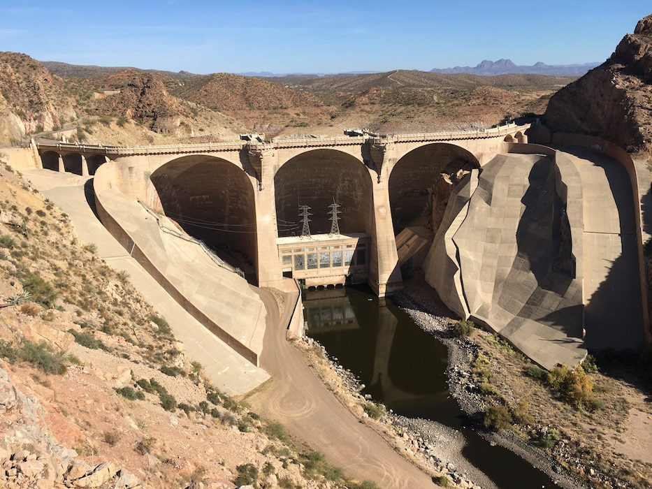 The downstream side of the Coolidge Dam, Nov. 14, 2019. The district is working on awarding a construction contract for the Bureau of Indian Affairs to upgrade the dam's hydraulic and electrical systems, install two 8-foot diameter butterfly valves, and work on the penstocks. The dam is located on the Gila River, on the San Carlos Indian reservation in Arizona, and is used for flood control and irrigation purposes. Photo by Todd Cleveland.