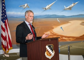 Art Thompson, Flight Test Museum Foundation Chairman, speaks at a special ceremony honoring Dr. Eileen Bjorkman, Air Force Test Center Executive Director, at Edwards Air Force Base, California, Feb. 25. Bjorkman recently donated $50,000 to Flight Test Museum Foundation to sponsor the RF-4C (#004) and help directly fund construction of the new Flight Test Museum being built outside the West Gate at Edwards Air Force Base. (Air Force photo by Giancarlo Casem)