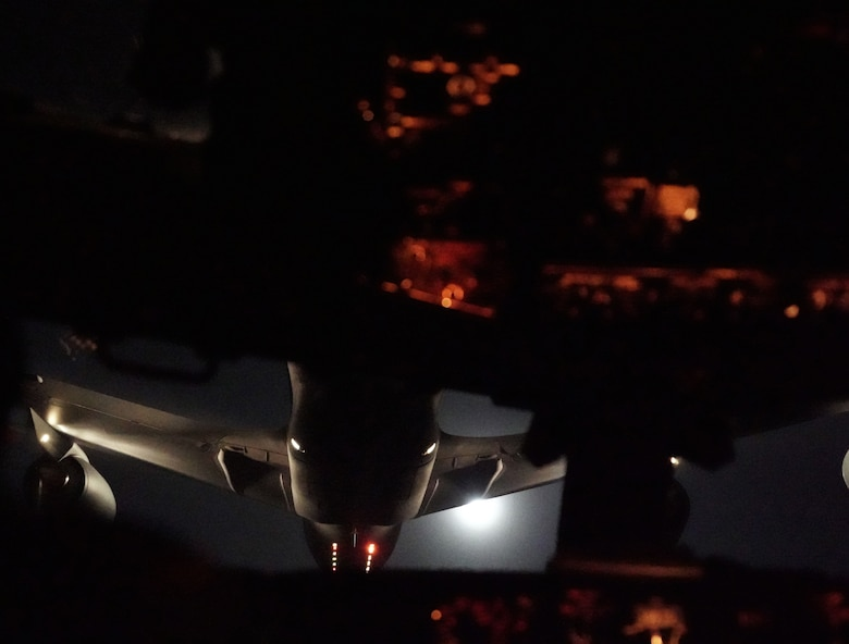A KC-135 conducts air refueling with a E-3G Sentry.