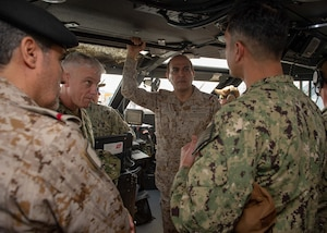 JUBAIL, Kingdom of Saudi Arabia 200223-N-JO908-1040 Lt. Cmdr. Jorge Roldan, commanding officer of Task Unit 56.7.5, right, explains the capabilities of the Mark VI patrol boat to Vice Adm. Jim Malloy, commander, U.S. Naval Forces Central Command, U.S. 5th Fleet, Combined Maritime Forces, left, and Vice Adm. Fahad al Ghofaily, Commander of the Royal Saudi Naval Forces (RSNF), during an underway in Jubail, Kingdom of Saudi Arabia as part of exercise Nautical Defender 20 (ND) Feb. 23. ND is a bilateral maritime exercise between the U.S. Navy and the RSNF designed to build and sustain warfighting capabilities, support long term regional security and enhance military-to-military interoperability with the U.S. and Kingdom of Saudi Arabia. (U.S. Navy photo by Mass Communication Specialist 1st Class Kory Alsberry)