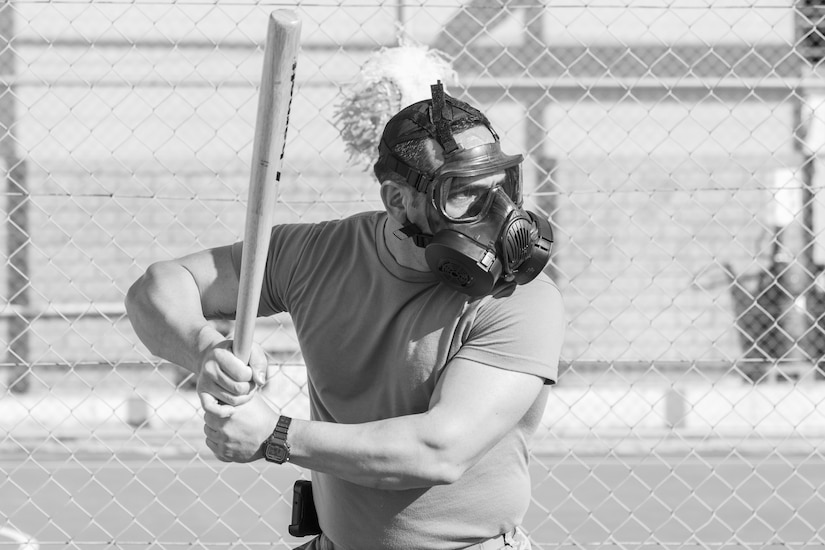 A U.S. Army Soldier, with 655 Regional Support Group, 316 Sustainment Command (Expeditionary), 377 Theater Sustainment Command, prepares to hit a ball during a game of gas mask baseball Feb. 12, 2020 at Joint Training Center-Jordan, paying tribute to former service members who used the sport to train for chemical warfare during WWI. We still have the greatest Army in the world. We serve the people of the United States and we are going to protect them with our lives if that is what it comes to. (U.S. Army photo by Sgt. 1st Class Shaiyla B. Hakeem)