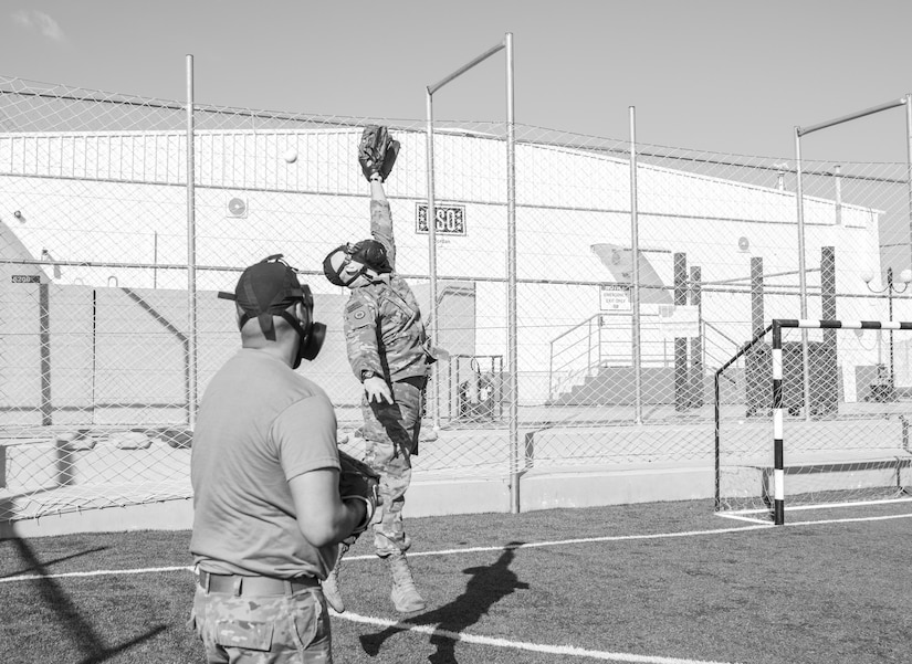 U.S. Army Soldiers, with 655 Regional Support Group, 316 Sustainment Command (Expeditionary), 377 Theater Sustainment Command, warm up before a game of gas mask baseball Feb. 12, 2020 at Joint Training Center-Jordan, paying tribute to former service members who used the sport to train for chemical warfare during WWI. We still have the greatest Army in the world. We serve the people of the United States and we are going to protect them with our lives if that is what it comes to. (U.S. Army photo by Sgt. 1st Class Shaiyla B. Hakeem)