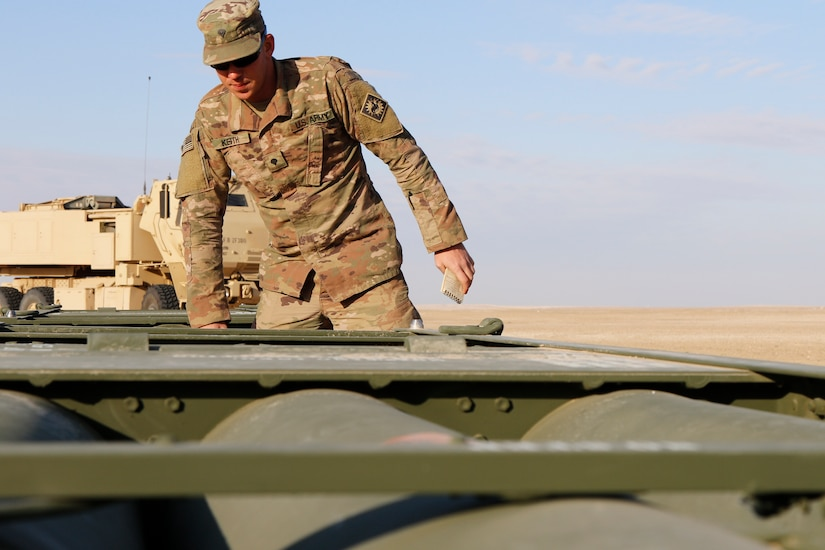 Wyoming National Guard Spc. Morgan Keith, a high mobility artillery rocket system gunner assigned to the 115th Field Artillery Brigade from Spearfish, South Dakota, inspects the missile rounds prior to loading during an exercise with Kuwait Land Forces at their Udairi Range, Monday, Feb. 10, 2020. The 115th Soldiers from the Wyoming-based unit deployed to support Task Force Spartan that strengthens defense relationships, builds partner capacity, and jointly deter regional aggression. U.S. Army photo by Master Sgt. Jeff Lowry, Task Force Spartan Public Affairs