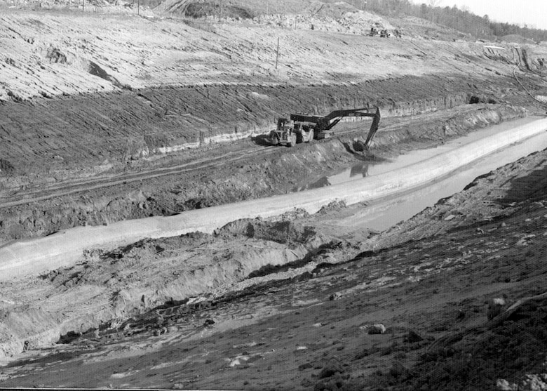 Crews remove soil during construction of the Tennessee-Tombigbee Waterway in Mississippi April 4, 1978. It took over 100-million dump truck loads of soil to connect the Tennessee and Tombigbee Rivers, opening a new passageway to the Gulf of Mexico in 1985. The Mobile District constructed the southern 195 miles of the Tennessee-Tombigbee Waterway, including nine locks and dams. The Nashville District excavated the northern 29 miles of the project, including the massive 27-mile divide cut, which connected the waterway with Pickwick Lake on the Tennessee River.  The Corps excavated nearly 310 million cubic yards of soil during the 12-year project.  In comparison, 210-million cubic yards of earth were removed from the Panama Canal.  In the end, the two districts, 125 prime contractors and 1,200 subcontractors worked on the overall waterway. The 10 locks and five dams required a total of 2.2 million cubic yards of concrete and 33,000 tons of reinforcing steel. (USACE Historical Photo)