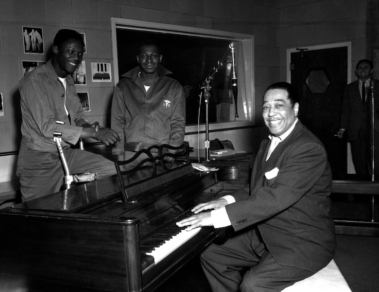 Jazz pianist Duke Ellington poses Nov. 3, 1954, at the KFG Radio Studio for Fitzsimons Army Medical Center in Aurora, Colorado. Ellington played three shows at Travis Air Force Base, California, in the 1950s and 1960s, one of which was released as a live album in the 1980s.(U.S. Army photo)