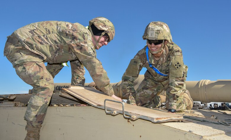 Pvt. Shawn Keiser, (left) a M1 Abrams tank system maintainer assigned to the 1st Battalion, 68th Armored Regiment, and Pfc. Jenicelee David – Rodrigues a M1 abrams tank system maintainer assigned to the 4th Squadron, 10th Cavalry Regiment, both from Fort. Carson, Colorado, change the battery out of an M1 Abrams System Enhancement Package v2 tank at Joint Base Charleston's Naval Weapons Station S.C., Feb 14, 2020. The 841st Transportation Battalion and the 3rd Armored Brigade Combat Team partnered to off load equipment from the shipping vessel Green Lake for a return to home station. The cargo was diverted to Joint Base Charleston and other ports on the east coast because of congestion at the Port of Beaumont, Texas. The 841st TB enables innovation and rapid global mobility by having a wide network of subject matter experts available to help load, unload, and transport equipment worldwide safely and efficiently.