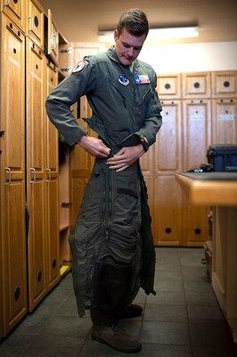Pilot puts on flight suit