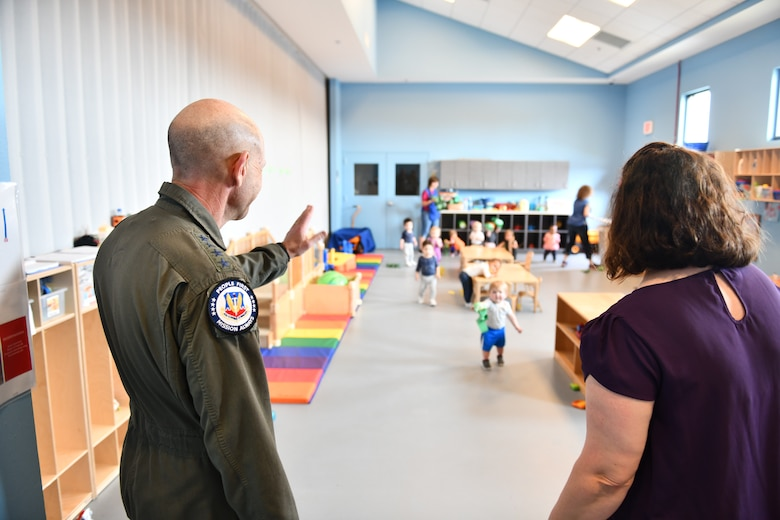 U.S. Air Force Gen. Mike Holmes, the commander of Air Combat Command, waves at children playing at the Child and Youth Program Center, Tyndall Air Force Base, Florida, Feb. 25, 2020. Holmes visited Tyndall to see how far it's come with rebuilding after Hurricane Michael. (U.S. Air Force photo by Senior Airman Stefan Alvarez)
